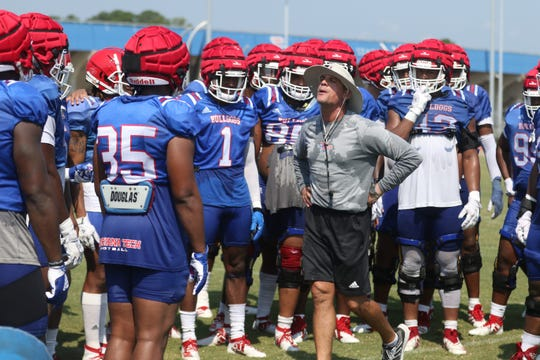 Louisiana Tech defensive coordinator Bob Diaco talks to his defense in between drills at fall camp.