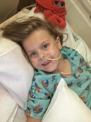 Annadelle Faulkner in the initial days after she developed sudden paralysis. Doctors would later diagnoses her with acute flaccid myelitis, an extremely rare and mysterious condition that affects primarily young children.