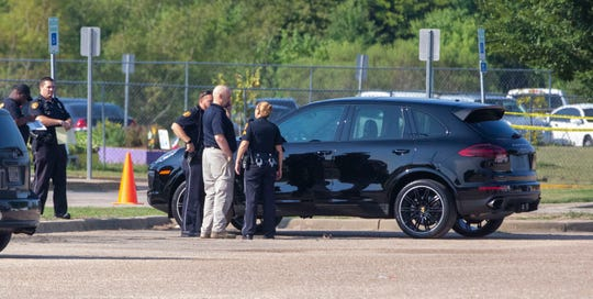 Two dads, one in the black Porsche, got into an argument while in the drop-off lane at Blount Elementary School which ended when one fired a gun at the other. No one was injured during the incident and both dads were detained following the shooting.