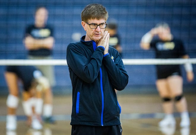 FILE -- Burris volleyball coach Steve Shondell leads his team in a practice earlier this month. The Owls won again Tuesday.