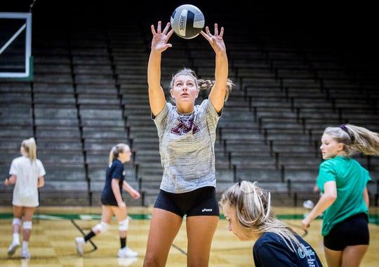 Senior setter Melani Shaffmaster runs through drills at New Castle High School Wednesday, Aug. 7, 2019.