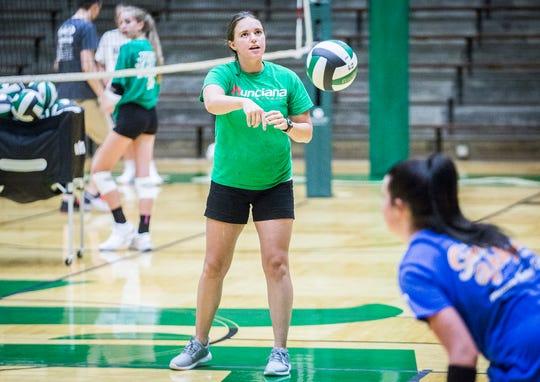 Coach Sarah Roush runs through drills at New Castle High School Wednesday, Aug. 7, 2019.