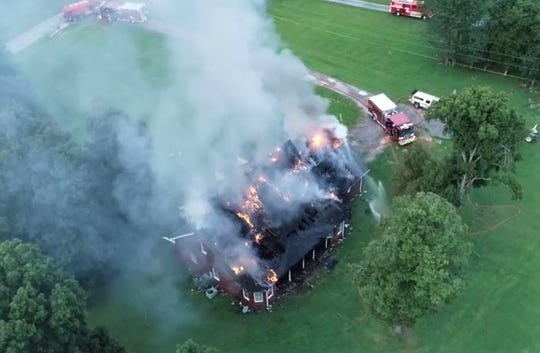 It took some time for firefighters to get control of Wednesday's blaze on Deer Run Road, as the nearest hydrant was located more than a mile away.