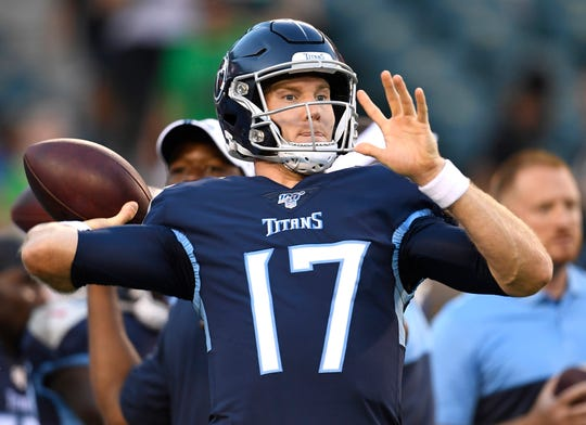 Tennessee Titans quarterback Ryan Tannehill (17) throws a pass before the start of the preseason game against the Eagles at Lincoln Financial Field Thursday, Aug. 8, 2019, in Philadelphia, Pa.