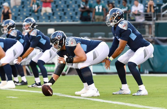 Tennessee Titans center Ben Jones (60) prepares to take the snap before the preseason game against the Eagles at Lincoln Financial Field Thursday, Aug. 8, 2019, in Philadelphia, Pa .