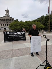 Kevin Riggs, a pastor at Franklin Community Church, speaks at a press conference announcing the March4Mercy. He holds a copy of the letter death row inmates sent to Gov. Bill Lee, asking him to spend time praying with them.