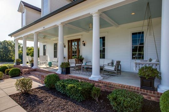 This home features a large front porch which can accommodate multiple seating areas.