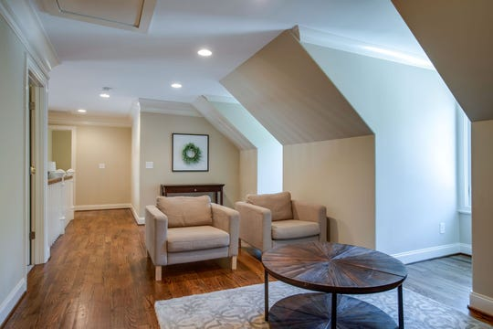 The upstairs has three bedrooms, a large bonus room and this beautiful flex space currently used as a TV area. Dormers give the room natural light and a unique roof line.