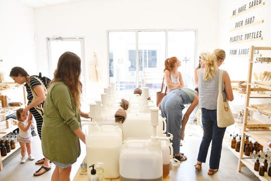 Shoppers look around at The Good Fill which is Nashville's first zero waste store (lets you refill bottles of dish soap, hair products, floss) Friday, Aug. 2, 2019, in Nashville, Tenn.