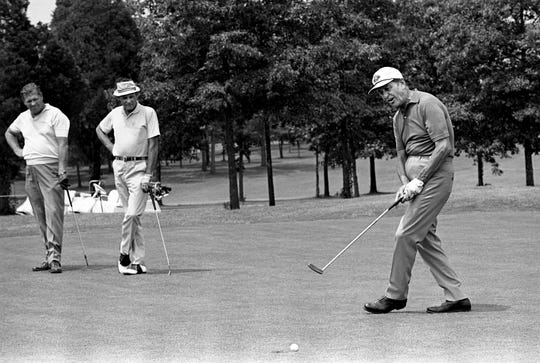 Internationally well-known entertainer Lawrence Welk, right, reacts as his putt stops just short of the cup as he plays with Gov. Buford Ellington and others at the Henry Horton State Park golf course Aug. 5, 1969.