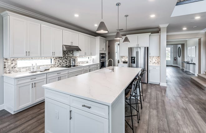 The Heatherton home design features an open concept floor plan. The kitchen offers additional space for casual seating at the spacious island.