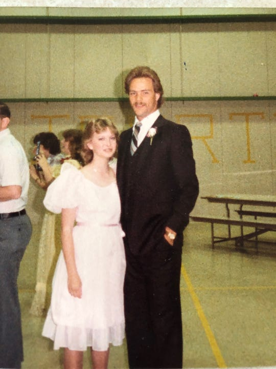 A photo of Jodi Priest (then Garwick) with teacher John Schouten at her eighth grade graduation.