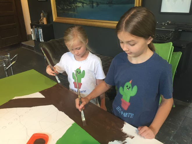Maya and Abbie Graham at work on the new mural for the Granville Parent Co-op Preschool.