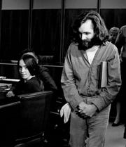 In this Oct. 13,1970 file photo, cult leader Charles Manson walks into the courtroom as Susan Atkins, a member of his family of followers, looks on in Santa Monica, Calif.