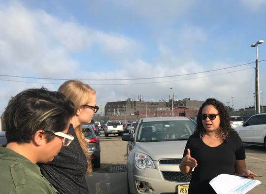Vicci Martinez and Emily Tarver, actors from Orange is the New Black,  speak to Rosa Santana, of First Friends, before heading inside the Hudson County jail to visit with immigrant detainees.