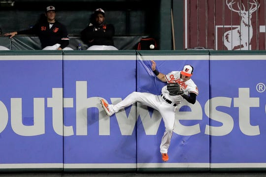 Baltimore Orioles center fielder Stevie Wilkerson goes up but is unable to catch a solo home run by New York Yankees' Brett Gardner during the ninth inning of a baseball game Tuesday, Aug. 6, 2019, in Baltimore. The Yankees won 9-4.