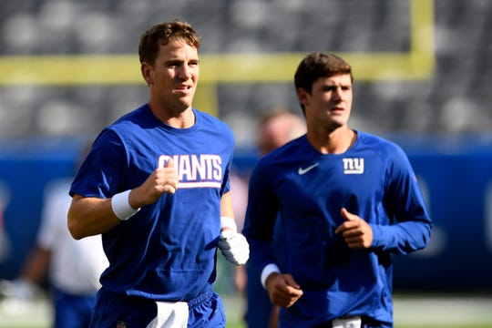 New York Giants quarterbacks Eli Manning, left, and Daniel Jones warm up on the field before the preseason game against the New York Jets on Thursday, August 8, 2019, in East Rutherford.