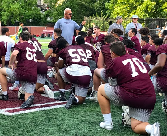 St. Peter's Prep coach Rich Hansen addresses his team after a recent practice in Jersey City.