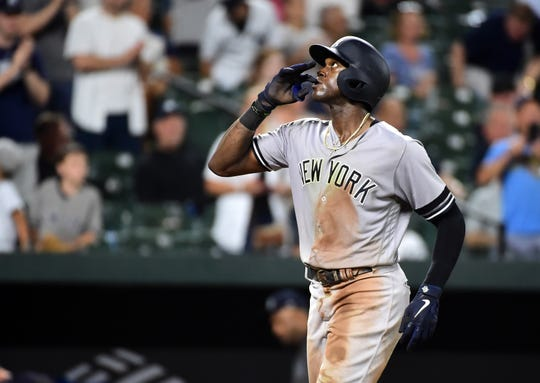 Aug 7, 2019; Baltimore, MD, USA; New York Yankees outfielder Cameron Maybin (38) reacts after hitting a home run in the ninth inning against the Baltimore Orioles at Oriole Park at Camden Yards.