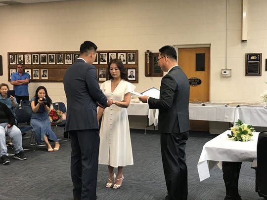 Palisades Park borough clerk Gina Kim wed Palisades Park police officer Stephen Kim during her lunch break at borough hall on Aug. 8