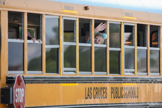 Children pile into a school bus at Alameda Elementary School in Las Cruces on Thursday, Aug. 8, 2019.