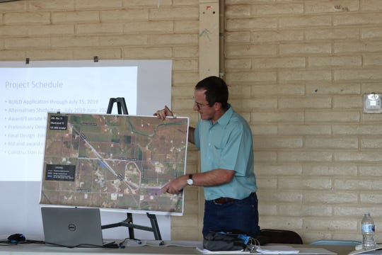 Clay Koontz, transportation engineer with Stantec, explains plans for a proposed intersection at U.S. 285 and State Road 31.