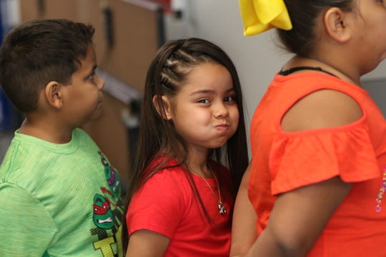 Elementary school students start their first day of the school year with a breakfast of fruit and pizza, Aug. 8, 2019 at Desert Willow Elementary.