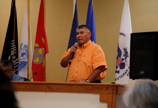 Navajo Nation Council Delegate Herman Daniels responds to public comments during the Resources and Development Committee special meeting on Aug. 6 at the Upper Fruitland Chapter house.