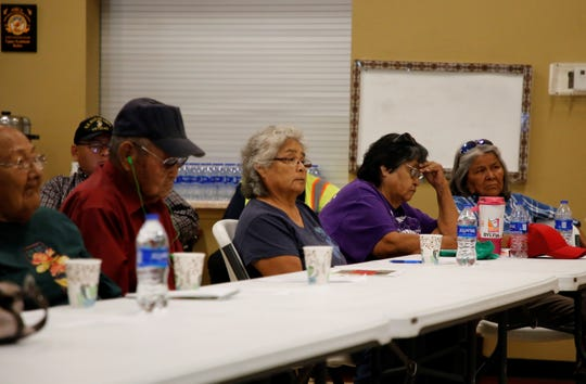 Community members listen to comments about a bill to approve leasing land to Navajo Agricultural Products Industry during the Resources and Development Committee special meeting  on Aug. 6 at the Upper Fruitland Chapter house.