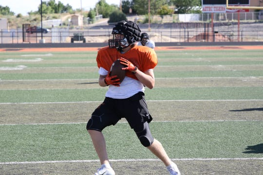 Aztec's Mikey Phillips pivots to the right after a catch and drives forward during practice on Wednesday, Aug. 7 at Fred Cook Stadium in Aztec. Phillips looks to build strong end to 2018 as a go-to target.