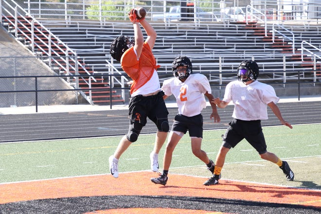 Aztec's Mikey Phillips jumps up in the right corner of the end zone for a touchdown reception during practice on Wednesday, Aug. 7 at Fred Cook Stadium in Aztec.