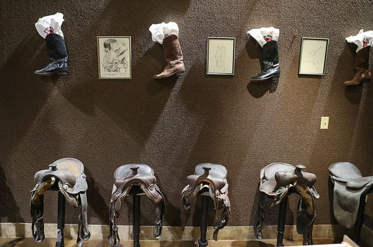 Old saddles said to have belonged to other cowboys of the western movies, including Roy Rogers and Gene Autry, and made into bar stools at Hopalong Cassidy's Palm Desert home are now for sale with some of his other belongings at the Habitat For Humanity Restore, August 8, 2019.