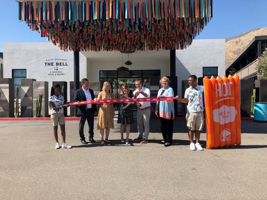 "Taco Bell organizers and Palm Springs officials cut the ribbon to ""The Bell"" experience on Aug. 8."