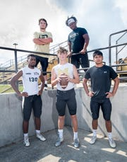 Clockwise from top left, Trevor Lunsford, Marquis Robinson, Noah Wingate, Tyler Buchanan, and Kam Hall during football practice at Milton High School on Wednesday, August 7, 2019.