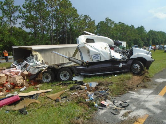 A semitruck carrying farm produce overturned on Interstate 10 in Santa Rosa County on Thursday, Aug. 8, 2019. Traffic was closed to just one lane for both eastbound and westbound travel as authorities cleared the roadway.