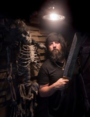 "Local bladesmith Wayne Meligan shows off his head hunter bolo machete at his Pirate Forge workshop in Pensacola on Thursday, August 8, 2018.  Meligan will be appearing on the History Channel's ""Forged in Fire"" competition on August 14th."