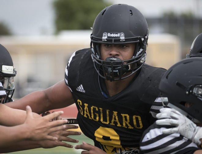 DL Quintin Somerville runs a drill during football practice, August 6, 2019, at Saguaro High School, 6250 N 82nd St., Scottsdale.