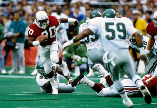 Phoenix Cardinals running back Stump Mitchell carries the ball during a game against the Philadelphia Eagles on Nov 27, 1988 at Veterans Stadium.