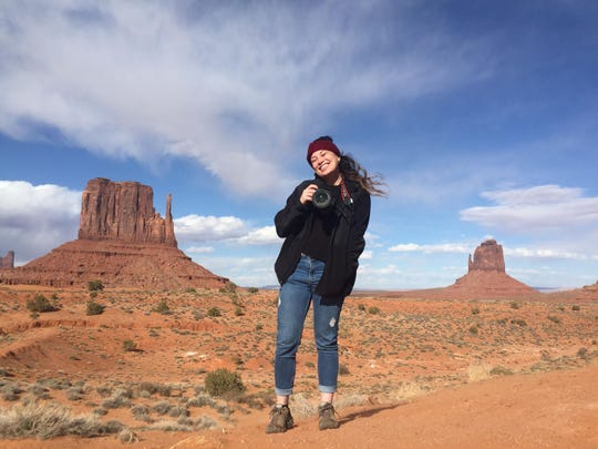 Megan U. Boyanton pauses her duties as a photographer to pose for a portrait at Monument Valley Navajo Tribal Park in April 2019.