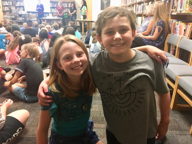 Mia Peterson, 10, and Isabella McCune, 9, on the first day of fifth-grade at Boulder Creek Elementary School in Phoenix.