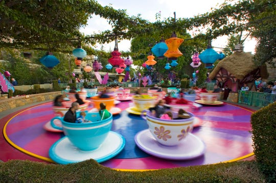"MAD TEA PARTY — Inspired by the classic Disney animated movie, ""Alice in Wonderland,"" the Mad Tea Party attraction at Disneyland Park recreates the film's madcap ""unbirthday"" sequence featuring the Mad Hatter and March Hare's chaotic tea party. The Mad Tea Party is located in Fantasyland in Anaheim, Calif. For editorial news use only. (Paul Hiffmeyer/Disneyland)"