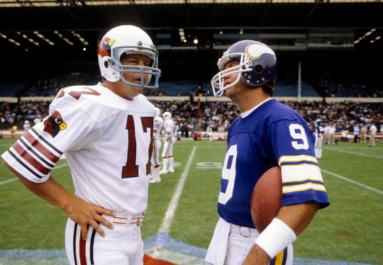 St. Louis Cardinals quarterback Jim Hart (17) talks with Minnesota Vikings quarterback Tommy Kramer (9) prior to the inaugural  NFL International Series game at Wembley Stadium on Aug 6, 1983.
