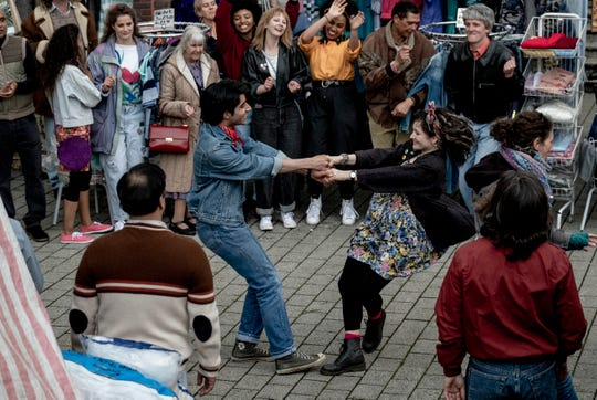 """Javed (Viveik Kalra) and Eliza (Nell Williams) dance in """"Blinded by the Light."""""""