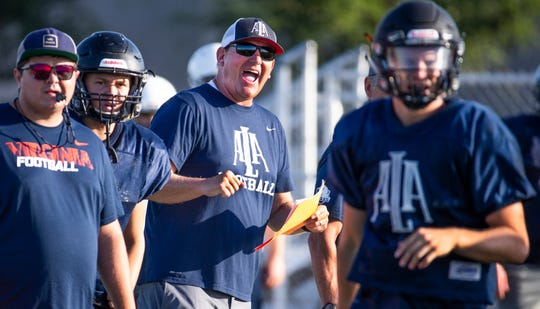 American Leadership Academy Gilbert North head coach Randy Ricedorff gives instructions to the team at the school, Thursday, August 8, 2019.