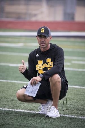 Coach Jason Mohn during football practice, August 6, 2019, at Saguaro High School.