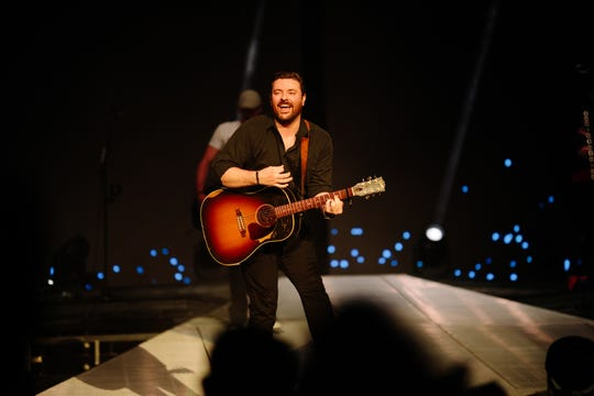 Chris Young enjoys performing in concert.