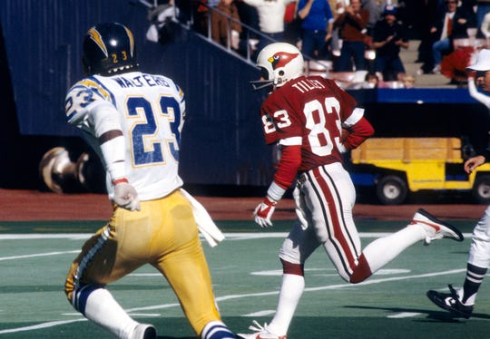 St. Louis Cardinals receiver Pat Tilley (83) is chased by San Diego Chargers defensive back Danny Walters (23) during a game Nov 20, 1983 at Busch Stadium.