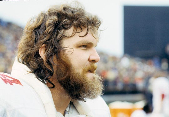 St. Louis Cardinals center Tom Banks looks on from the sideline during a game Nov 6, 1977 against the Minnesota Vikings at Metropolitan Stadium.
