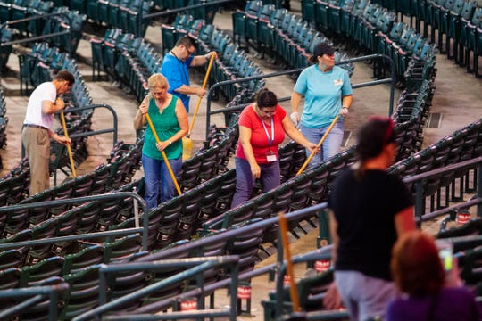 Volunteers deep clean Chase Field stadium in preparation for the 2019 International Convention of Jehovah's Witnesses on Aug. 8, 2019, in downtown Phoenix.