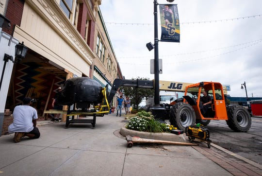 Crews use a SkyTrak lift to maneuver a brick pizza oven into BellaBolla in downtown Port Huron Thursday, Aug. 8, 2019. The store is opening at 309 Huron Ave. in downtown Port Huron.